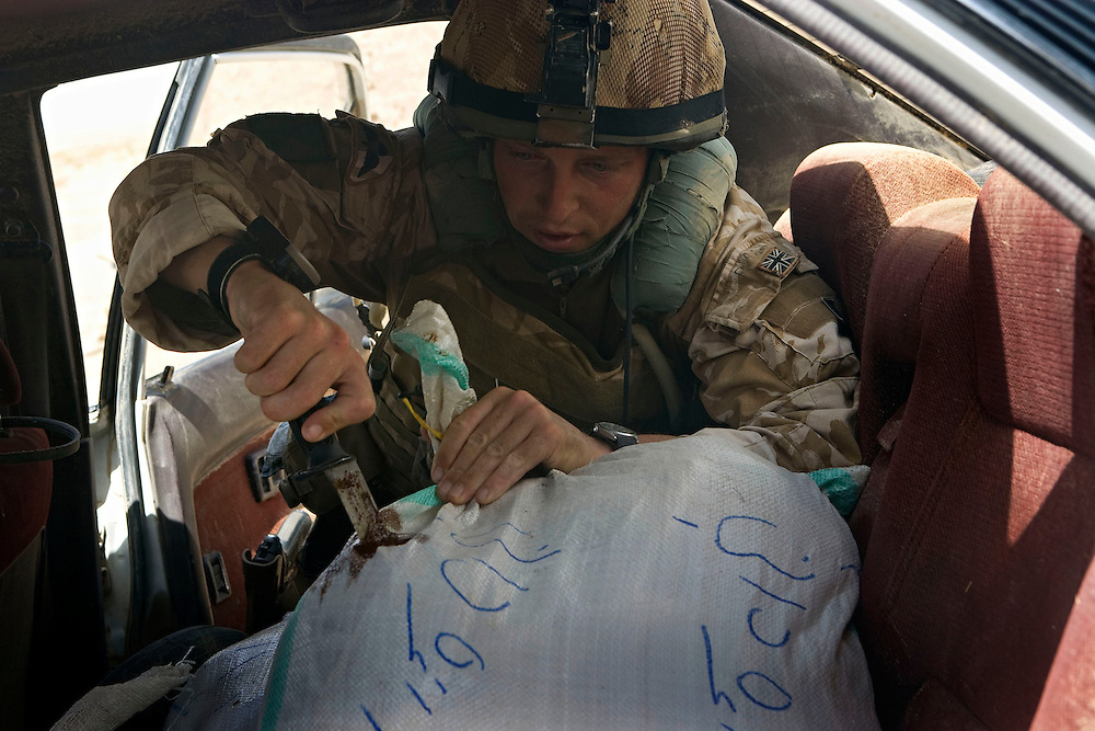 British soldiers of 3rd Battalion The Parachute Regiment discover arround 75 kgs of opium hidden in a car near their traget during an airborne assault as part of Operation 'Southern Beast'. Kandahar Province, Afghanistan on the 3rd of August 2008.