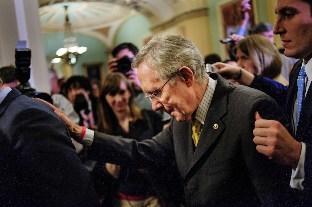 Senate Majority Leader Harry Reid (D-NV) is escorted througha crowd of reporters as he walks to the Senate Floor following a party caucus meeting at the U.S. Capitol. Fiscal cliff negotiations continue at the U.S. Capitol in Washington, District of Columbia, U.S., on Sunday, Dec. 30, 2012. A combination of spending cuts and tax increases are set to kick in within hours unless congressional Republicans and Democrats cut a last-minute deal. Photographer: Pete Marovich/Bloomberg