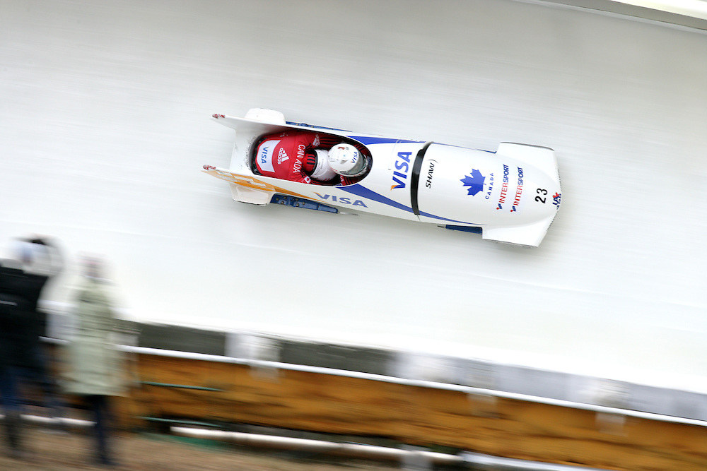 (November 21, 2009) Amanda Stepenko and Amanda Moreley of Canada fly through the 'Shady' corner enroute to a 12th place finish in the two-man bobsled at  the Federation Internationale de Bobsleigh et de Togogganing (FIBT) two-man men's bobsled World Cup race at the Olympic Sports Complex in Lake Placid, New York.