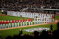 Both teams line for the National Anthem prior to Game 1 of the 2009 World Series between the New York Yankees and The Philadelphia Phillies in Bronx, NY. (Photo by Robert Caplin)..