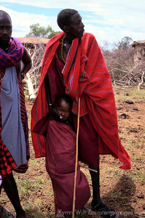 Africa, Kenya, Maasai Mara. Maasai elder and child at Olanana.