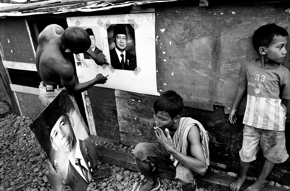 Putting up election campaign posters in Senen, one of Jakarta's poorest areas Indonesia June 1999