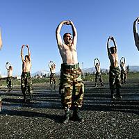 Iraqi Kurdish Peshmerga's, part of a brigade based around the Kurdish capital of Suleimaniya, stretch during a training exercise at the main Peshmerga base outside of the city of Suleimaniya, in northern Iraq. February 2005.