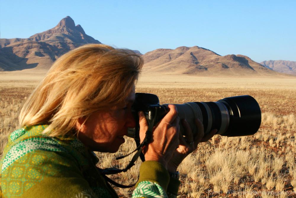 Africa, Namibia, Sossusvlei. Photographer in the Namib Rand.
