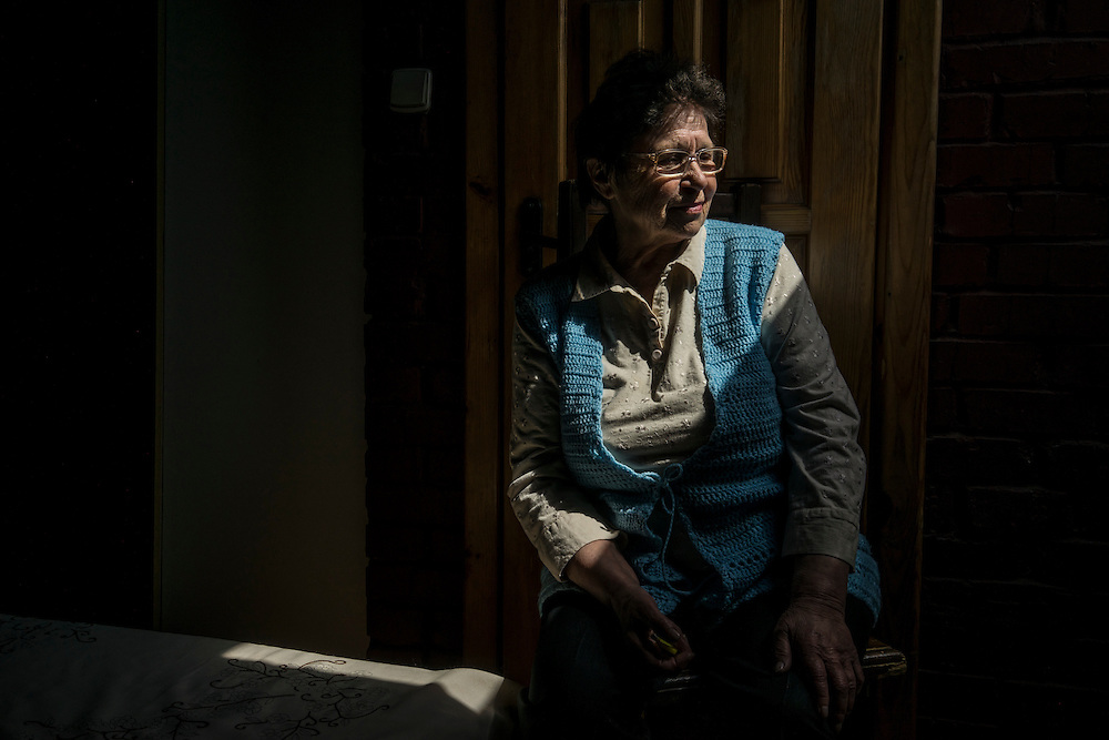 Mariia Halichenko, 75, from the city of Lugansk, poses for a portrait in the room she rents at a hotel on Tuesday, April 28, 2015 in Lviv, Ukraine. Halichenko fled fighting in eastern Ukraine. CREDIT: Brendan Hoffman/Prime for the Wall Street Journal UKRMIGRATION