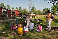 Big Horn County Historical Museum, school children, spinning demonstration, Hardin, Montana