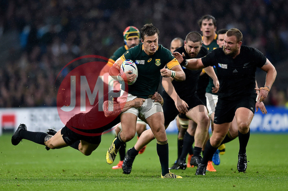 Handre Pollard of South Africa takes on the New Zealand defence - Mandatory byline: Patrick Khachfe/JMP - 07966 386802 - 24/10/2015 - RUGBY UNION - Twickenham Stadium - London, England - South Africa v New Zealand - Rugby World Cup 2015 Semi Final.