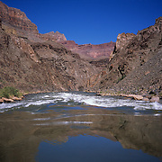 View from a raft running the rapids of the Colorado River through the very heart of the Grand Canyon in Grand Canyon National Park, AZ.