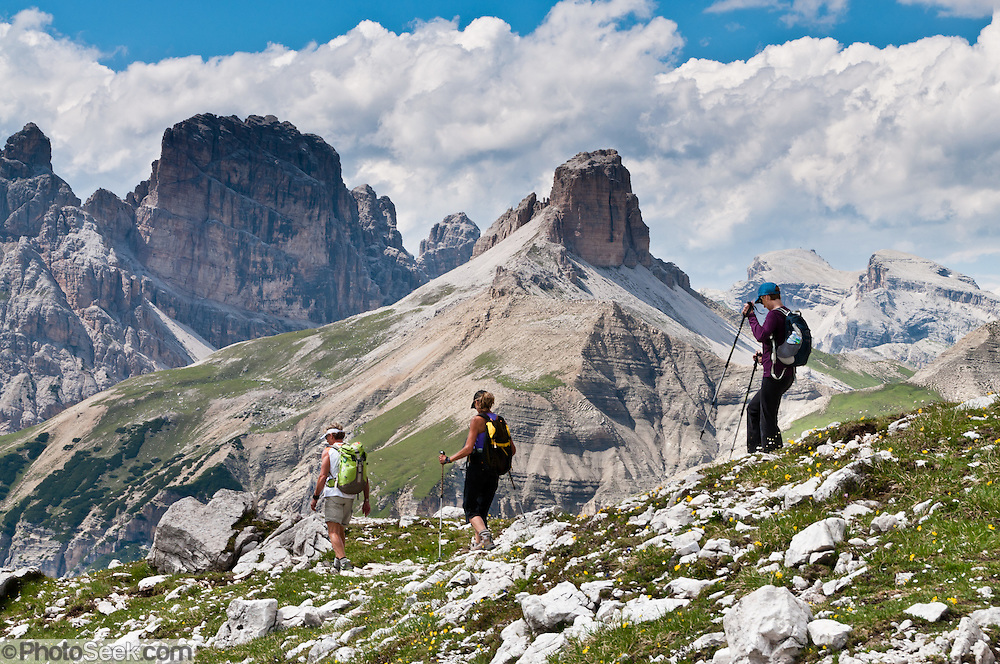 """Walk near Rifugio Locatelli (Dreizinnenhütte) in the Sexten Dolomites Nature Reserve (Parco Naturale Dolomiti di Sesto, or Naturpark Sextner Dolomiten), Italy, Europe. Hike for spectacular views around Tre Cime di Lavaredo (Italian for """"Three Peaks of Lavaredo,"""" also called Drei Zinnen or """"Three Merlons"""" in German). Until 1919 the peaks formed part of the border between Italy and Austria. Now they lie on the border between the Italian provinces of South Tyrol and Belluno and still are a part of the linguistic boundary between German-speaking and Italian-speaking majorities. The Dolomites were declared a natural World Heritage Site (2009) by UNESCO. Published in Wilderness Travel 2017 Catalog of Adventures."""