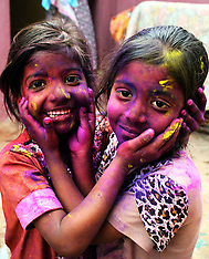 MAR 16 2014 Hindu children with coloured powder on their faces