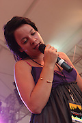 Lily Allen performs during the second day of the 2007 Bonnaroo Music & Arts Festival on June 15, 2007 in Manchester, Tennessee. The four-day music festival features a variety of musical acts, arts and comedians..Photo by Bryan Rinnert.
