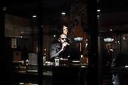 A man smoking a cigar at the Cigar Bar in Soho, London