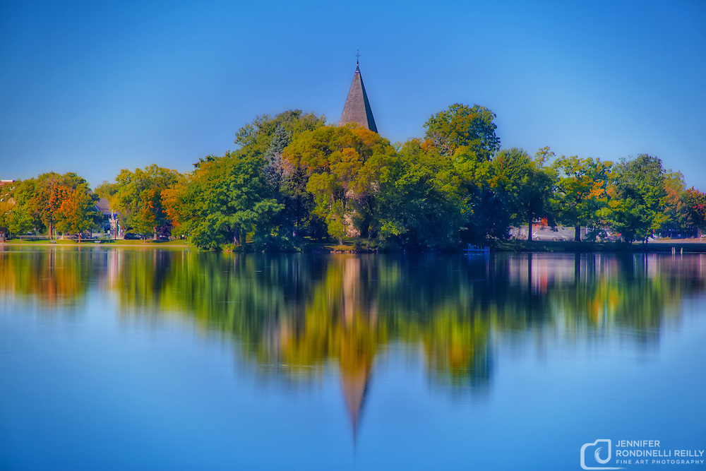 Reflections of downtown Oconomowoc in Fowler Lake.