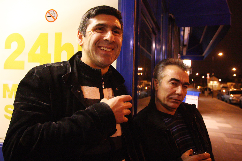 Hassan (left) with Cebrail Polat<br /> Drivers at Circle Cars, Turnpike Lane N8<br /> Country of birth: Turkey