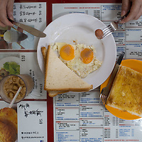 Office worker's breakfast, Hong Kong. Fried eggs and sausage, toast (dry and buttered), iced milk tea.