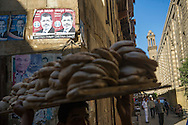 Political posters, including those of Egyptian President Mohamed Morsi, are posted on the wall outside a line of shops on a street bordering  Al-Azhar Mosque on November 10, 2012 in the Islamic district of old Cairo, Egypt. Al-Azhar is attempting to remain independent despite pressure from political groups, the government and the Islamist movement. Ann Hermes/© The Christian Science Monitor 2012