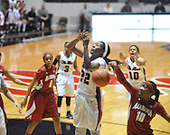 Ole Miss' Danielle McCray (22) has her shot blocked by Alabama's Meghan Perkins (10) in NCAA women's basketball action in Oxford, Miss. on Sunday, January 13, 2013.  Alabama won 83-75.