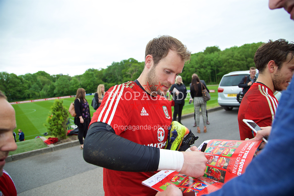 CARDIFF, WALES - Wednesday, June 1, 2016: Wales' goalkeeper Owain Fon Williams signs autographs for supporters after a training session at the Vale Resort Hotel ahead of the International Friendly match against Sweden. (Pic by David Rawcliffe/Propaganda)