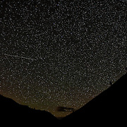 A couple of bright meteors, part of the Camelopardalid Meteor Shower, streak across Swakane Canyon in central Washington state. The weak meteor shower, which originated from dust from comet 209P/LINEAR, resulted in a peak display of between 5 and 10 meteors per hour in late May, 2014.