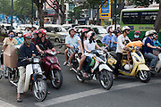 Masked motor scooter riders wait at the traffic lights, Ho Chi Minh City,Vietnam