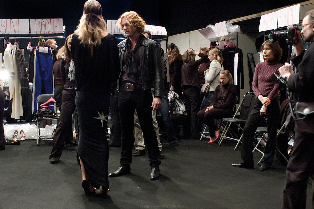 designer Peter Dundas getting models ready backstage before Ungaro fashion show