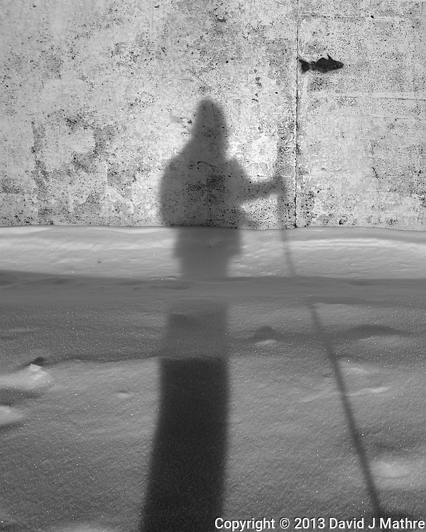 Shadow photographer fishing in Tromsø, Norway. Image taken with a Leica X2 camera (ISO 100, 24 mm, f/5.6, 1/400 sec). Raw image processed with Capture One Pro (including conversion to B&W).