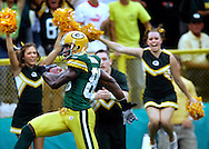 Donald Driver scores on a long touchdown pass from Brett Favre..The Green Bay Packers hosted the Cleveland Browns at Lambeau Field Sunday September 18, 2005. Steve Apps-State Journal.