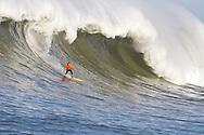Anthony Tashnik, third place finisher at the 2010 Mavericks Surf Contest, surfs a giant wave during the seond heat - Half Moon Bay, California - February 13, 2010
