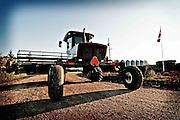 A swather is parked in a farmyard near Birch Hills, Saskatchewan.