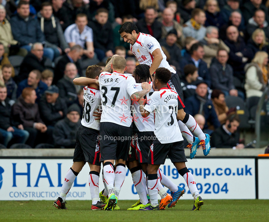HULL, ENGLAND - Sunday, December 1, 2013: Liverpool's captain Steven Gerrard celebrates scoring the first goal against Hull City with team-mates during the Premiership match at the KC Stadium. (Pic by David Rawcliffe/Propaganda)