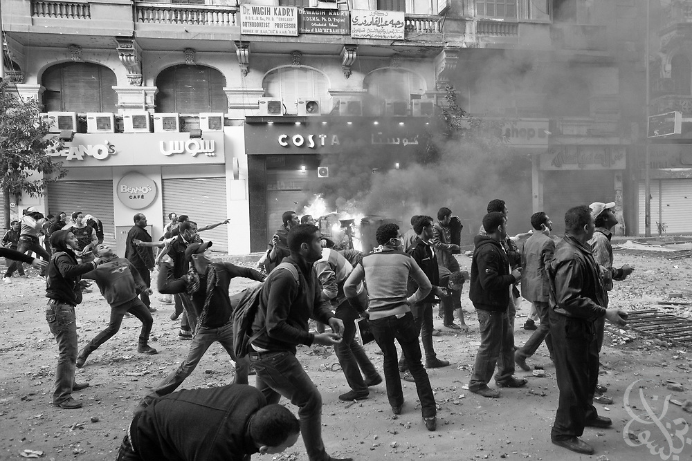 Egyptian protestors hurl rocks towards Central security force lines during ongoing demonstrations November 20, 2011 near Tahrir square in central Cairo, Egypt.  Protestors demanding the transition of power from military to civilian control clashed with Egyptian security forces for a second straight day in central Cairo, with hundreds injured and at least 11 protestors killed.  (Photo by Scott Nelson)