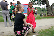Sasha Obama, daughter of Democratic presidential hopeful Senator Barack Obama, is watched by a campaign staffer as she eats ice cream as her mother Michelle Obama speaks to supporters during a rally in Concord, New Hampshire June, 2, 2007. .