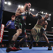 Lightweight boxing pro Joltin Joey Tiberi of Wilmington Delaware (L) in action during champs at the chase against Lightweight boxing pro Antoine Knight (R) Friday, Nov 21, 2014 at The Case Center on The River Front in Wilmington, Del.