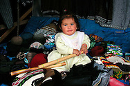 Small child at a roadside marketplace in Cotopaxi National Park, Ecuador.