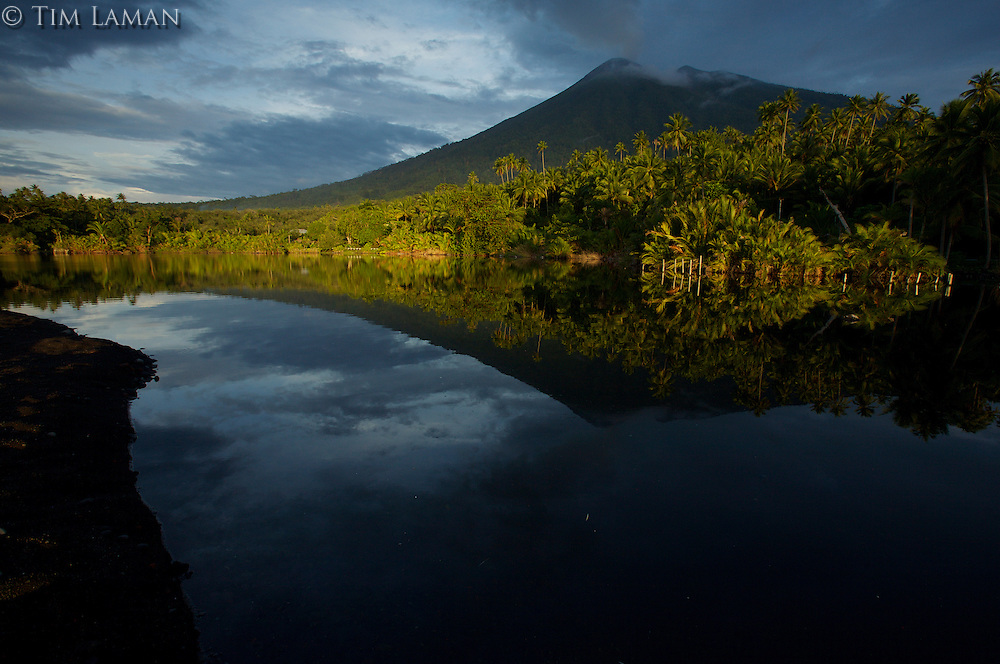 Sunset light illuminates Mount Gamalama volcano - an active volcano on Ternate Island, North Moluccas, Indonesia.<br /> Alfred Russel Wallace used this famous Spice Islands port as a base, and sent his famous letter to Darwin from this island.