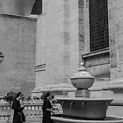 Nuns gathering for a drink from the fountain, Vatican City, Rome, Italy