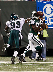 Sept 3, 2009; East Rutherford, NJ, USA;   New York Jets wide receiver David Clowney (87) catches a touchdown pass over Philadelphia Eagles cornerback Jack Ikegwuonu (33) during the second half at Giants Stadium.  The Jets defeated the Eagles 38-27.