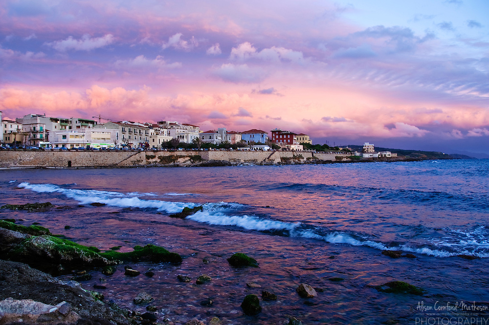 Sun sets over Alghero in Sardinia, Italy.