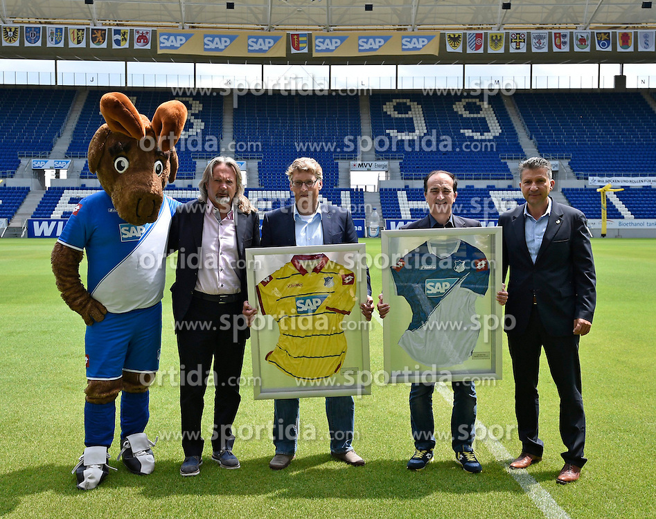 06.07.2014, Wirsol Rhein Neckar Arena, Sinsheim, GER, 1. FBL, TSG 1899 Hoffenheim, Training, im Bild Praesentation neuer Trikots mit Maskottchen Hoffi, Geschaeftsfuehrer Peter Rettig TSG 1899 Hoffenheim Andrea Tomat Direktor lotto sports Praesident Peter Hofmann TSG 1899 Hoffenheim v.li.: // during a Trainingssession of German Bundesliga Club TSG 1899 Hoffenheim at the Wirsol Rhein Neckar Arena in Sinsheim, Germany on 2014/07/06. EXPA Pictures &copy; 2014, PhotoCredit: EXPA/ Eibner-Pressefoto/ Weber<br /> <br /> *****ATTENTION - OUT of GER*****
