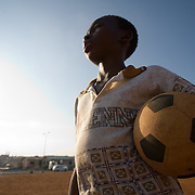 Boy holding football in Accra, Ghana, 2006.