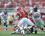 Ole Miss defensive tackle Ted Laurent (99) reaches for Arkansas running back Knile Davis (7) at Reynolds Razorback Stadium in Fayetteville, Ark. on Saturday, October 23, 2010.