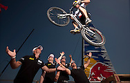 Extreme Sailing Series 2011. Leg 1. Muscat. Oman.Red Bull Kenny Delay 9 times world champion in trial biking at The Wave, Muscat