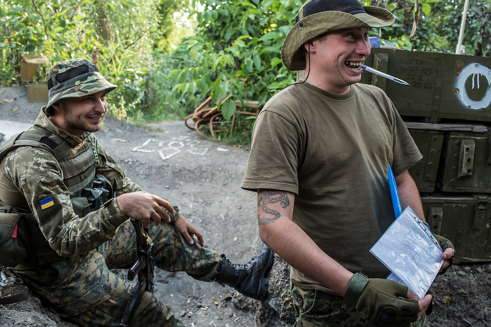 AVDIIVKA, UKRAINE - JULY 9, 2016: Lt. Denis Naumov, a Ukrainian Army press officer with the 58th brigade, left, and Sgt. Ruslan Pilipenko, in a front-line bunker in Avdiivka, Ukraine. The town is now one of the most active areas of fighting along the line of control between the Ukrainian government and Russian-backed rebels. CREDIT: Brendan Hoffman for The New York Times
