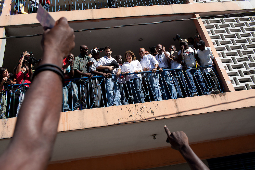 Haitian presidential candidate Michel Martelly rallies supports at a polling station after casting his ballot in presidential and legislative elections in Port-au-Prince, Haiti.
