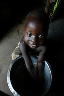 October 6, 2006 - A child washes his hands before a meal in Coope camp for internally displaced people, or IDP, near Gulu in north Uganda. Coope, with a population of 18,000, is one of 76 IDP camps around Gulu, the main base for the Uganda Peoples Defense Force fighting the insurgent Joseph Kony's Lord's Resistance Army. Kony's LRA movement has been fighting for the past 20 years to force the East African country to be ruled according to the Christian Ten Commandments. Over 2 million people, mostly of the Acholi tribe, have moved or were forced to move from their villages to camps close to the towns of Gulu, Lira, and Kitgum where they are watched over by the Ugandan Army. The LRA rebels have abducted thousands of children and have forced them to fight against the Ugandan Army and the Acholi people. Current peace talks between Kony's LRA and the Ugandan government held in Juba, southern Sudan, offer a glimpse of hope to ending this ongoing conflict..(Photo by Jakub Mosur/Polaris)<br />