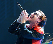Bono of U2 sings at a performance in Miami, Florida in 2005. Colin Braley-Photography
