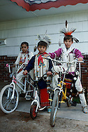Kiowa Indian kids ride bicycles before going to powwow, Oklahoma, <br /> MODEL RELEASED