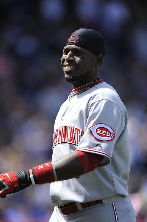 CHICAGO - APRIL 23:  Brandon Phillips #4 of the Cincinnati Reds smiles as he walks back to the dugout during the game against the Chicago Cubs on April 23, 2009 at Wrigley Field in Chicago, Illinois.  The Reds defeated the Cubs 7-1.  (Photo by Ron Vesely)