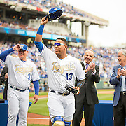 KANSAS CITY, MO - APRIL 5, 2016: Salvador Perez #13 of the Kansas City Royals acknowledges the crowd after receiving his 2015 World Series Championship ring during pre-game ceremonies before the game between the New York Mets and the Kansas City Royals at Kauffman Stadium on April 5, 2016 in Kansas City, Missouri. (Photo by Jean Fruth)