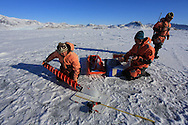 Marine chemists Melissa Chierici (Institute of Marine Research) and Agneta Fransson (Norwegian Polar Institute) process ice core atop frozen fjord; Kongsfjord, Svalbard, Norway.